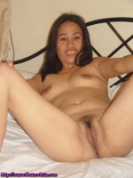 Older Asian spreading her legs wide