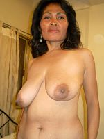 An horny mature Asian granny toying