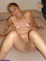 Mature Asian granny shows wet pussy