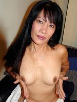 Older Asian in her stockings toying