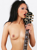 Topless Janice licking her Les Paul