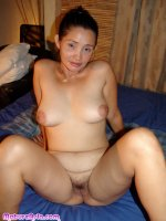 Mature Asian pussy spread wide open