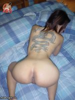 Asian Babe with sexy full back tat